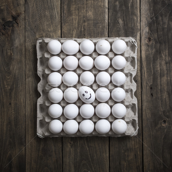 Carton of organic eggs on wooden background.  Stock photo © nessokv