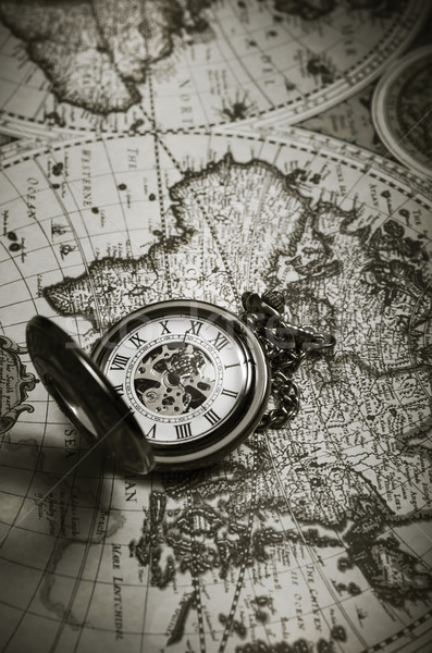 Vintage antique pocket watch on old map background Stock photo © nessokv