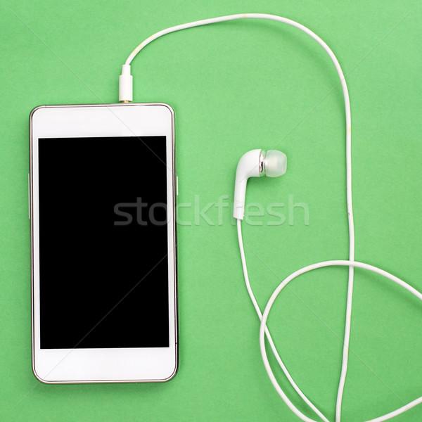Okostelefon fülhallgató fehér izolált képernyő zöld Stock fotó © nessokv