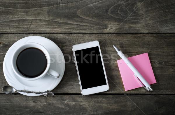 Telefon csésze kávé öreg fából készült asztal Stock fotó © nessokv