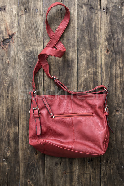 red purse on wooden background Stock photo © nessokv