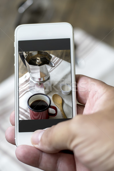 Hand of man taking photo of his cup of coffee Stock photo © nessokv