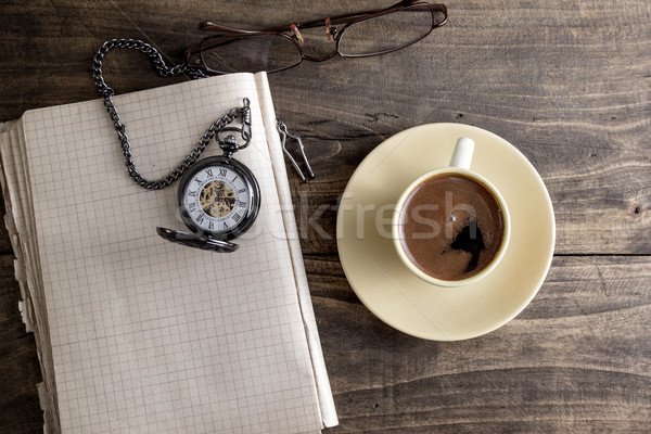 Vintage pocket watch with cup of coffee on old book Stock photo © nessokv