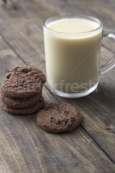 Cookies melk houten tafel glas tabel Stockfoto © nessokv