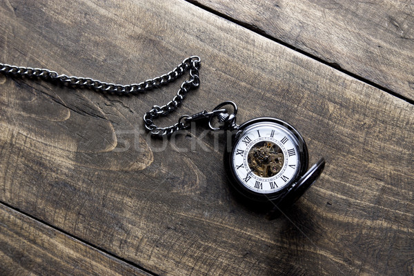 pocket watch on grunge wooden table Stock photo © nessokv