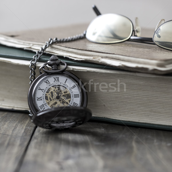 An antique pocket watch, glasses and bible  Stock photo © nessokv