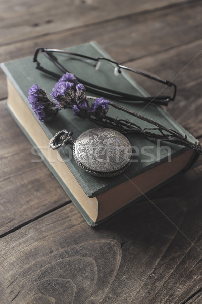 Antique pocket watch, glasses and book Stock photo © nessokv