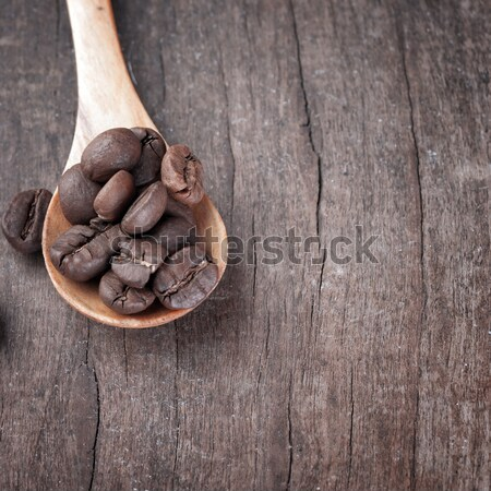 almonds in  bowl on grained wood background Stock photo © nessokv