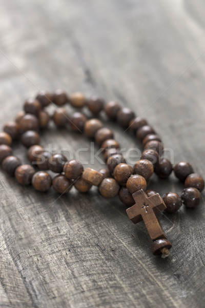 Wooden rosary beads on old wooden background Stock photo © nessokv