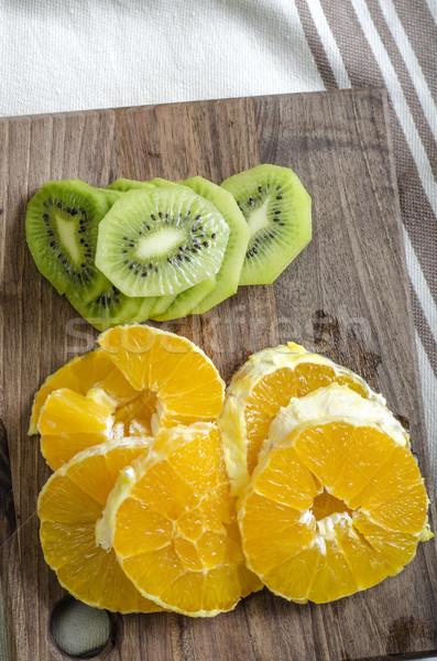 Kiwi orange tranches planche à découper fruits sweet Photo stock © nessokv