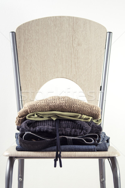 Stack of clothes on a Wooden Chair Stock photo © nessokv