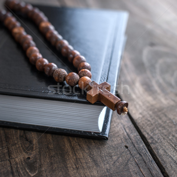 Wooden rosary beads and holy bible Stock photo © nessokv
