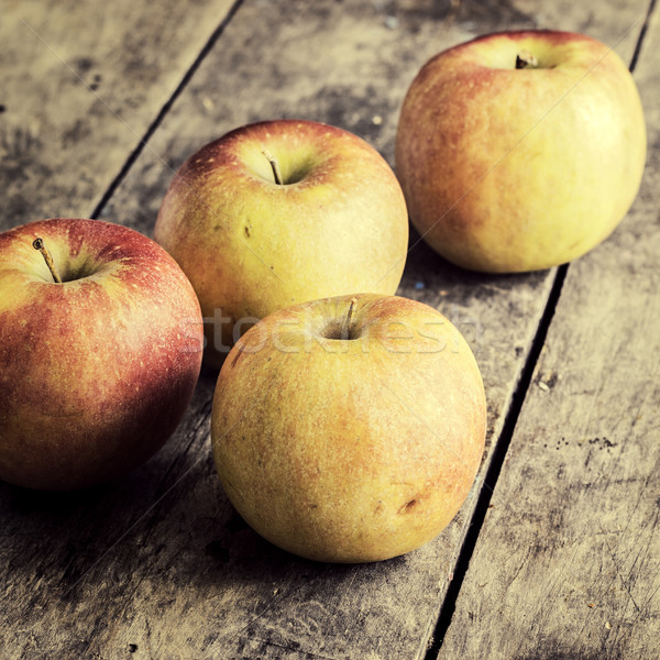 ripe apples on a dark wooden table Stock photo © nessokv