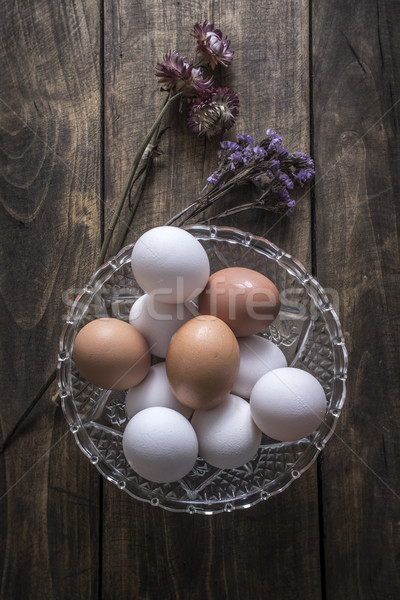 Brown and white chicken eggs in glass bowl Stock photo © nessokv
