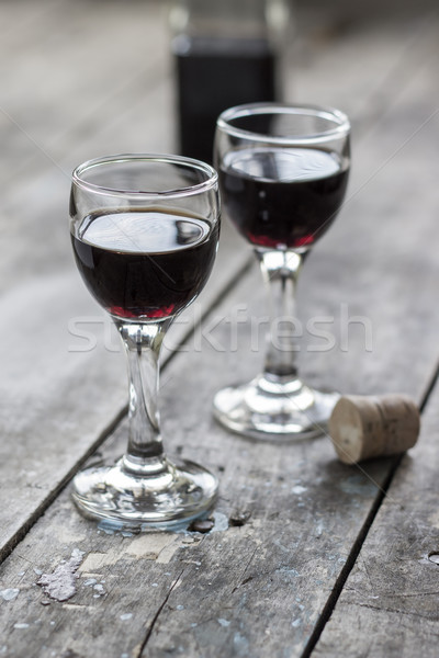 glass of cherry liqueur on wooden table Stock photo © nessokv