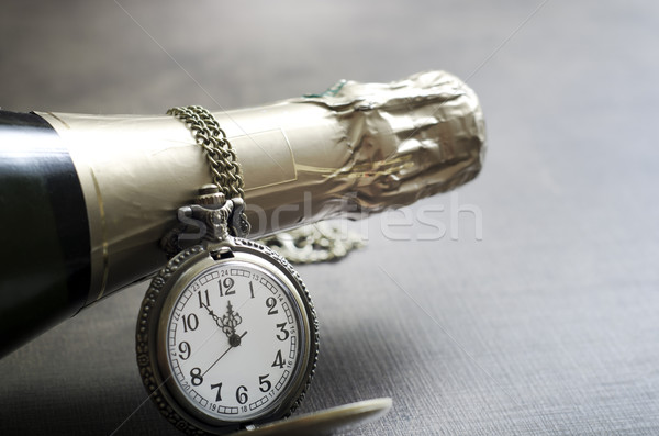 New Year's clock and champagne at midnight Stock photo © nessokv
