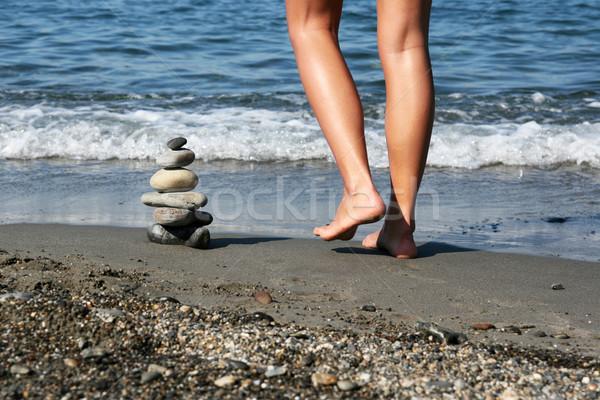 Pile of Stones and Female Legs Stock photo © newt96