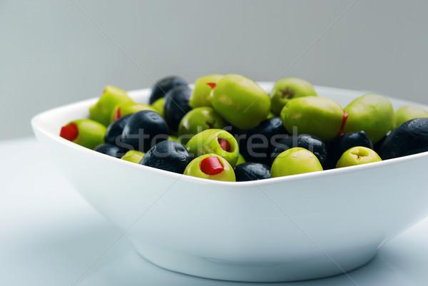 Azeitonas recheado vermelho pimentas fruto verde Foto stock © nezezon