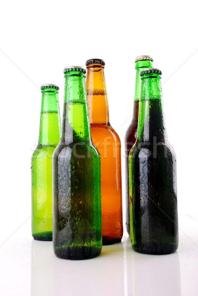 Groene bierfles waterdruppels witte abstract bar Stockfoto © nezezon