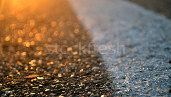 Aszfalt út narancs naplemente nap tájkép Stock fotó © nezezon