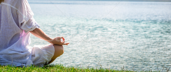 Woman meditating at the lake Stock photo © Nickolya