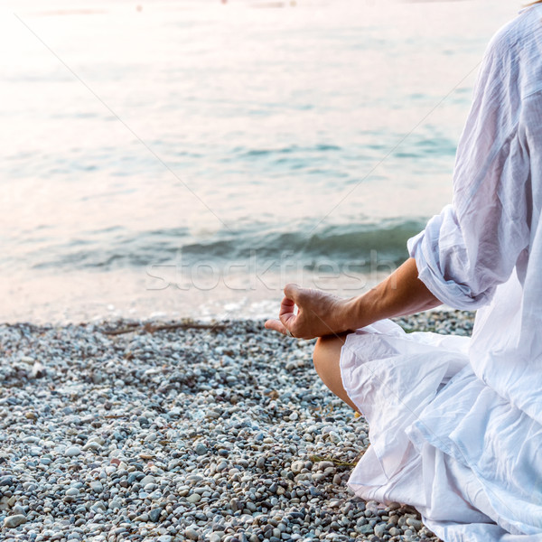 Woman meditating at the sea Stock photo © Nickolya