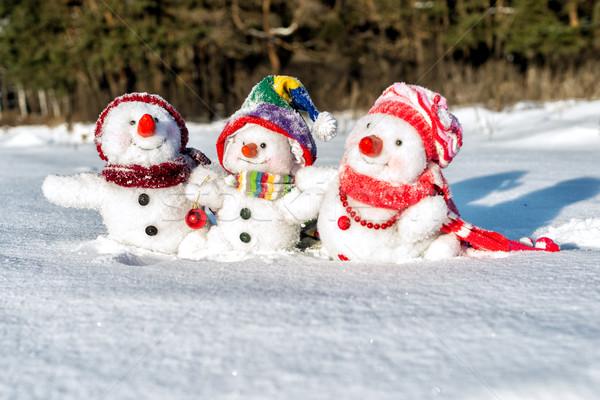 Gelukkig sneeuwpop familie hoeden achtergrond winter Stockfoto © Nickolya
