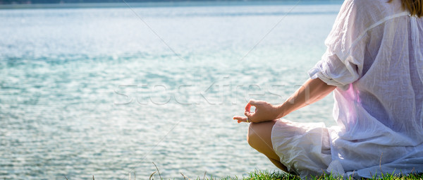 Woman meditating at the lake Stock photo © Nickolya