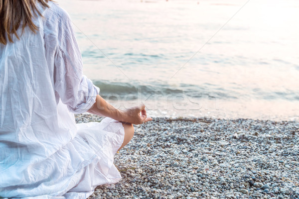 Woman meditating at the sea Stock photo © Nickolya