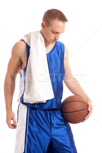 Male basketball player. Studio shot over white. Stock photo © nickp37