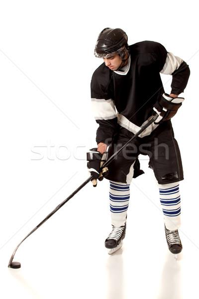 Ice hockey player. Studio shot over white. Stock photo © nickp37