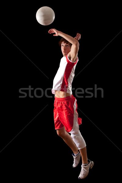 Male volleyball player. Studio shot over black. Stock photo © nickp37
