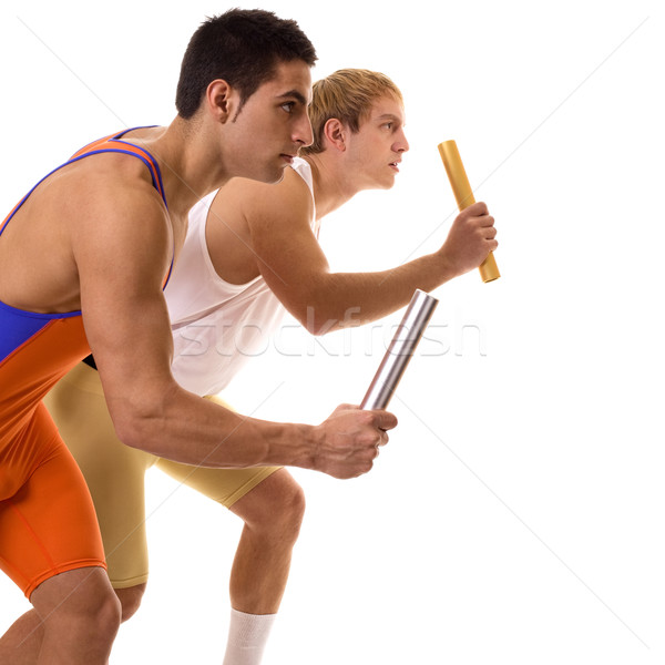 Track and field athletes competing in a relay race. Studio shot over white. Stock photo © nickp37