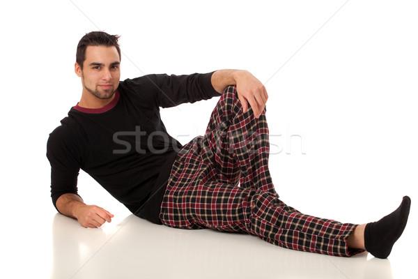 Stock photo: Attractive man in pajamas. Studio shot over white.