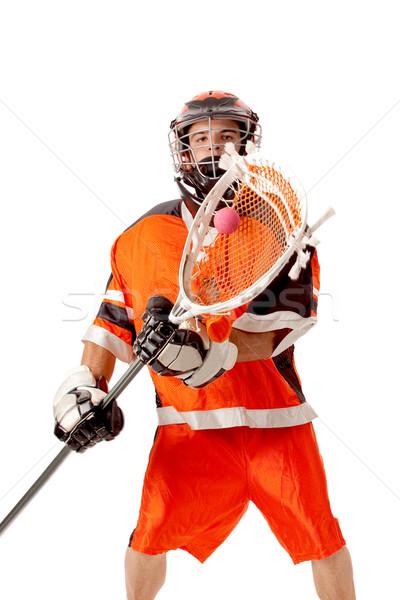 Male lacrosse player. Studio shot over white. Stock photo © nickp37