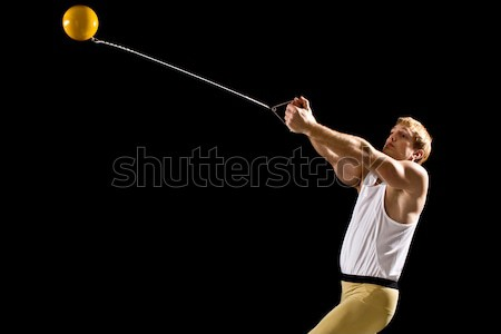 Track and field athlete competing hammer throw. Studio shot over white. Stock photo © nickp37