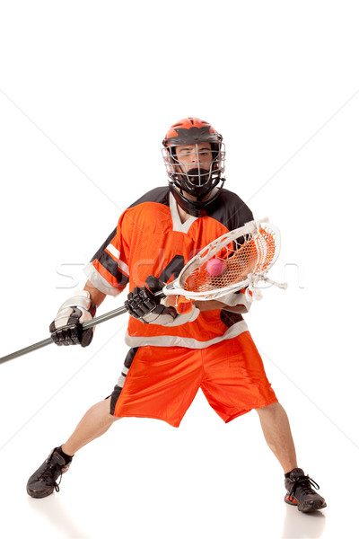 Male lacrosse player. Studio shot over white. Stock photo © nickp37