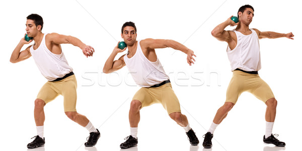 Track and field athlete competing shot put. Studio shot over white. Stock photo © nickp37