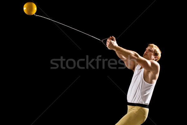 Athlete competing in hammer throw. Studio shot over black. Stock photo © nickp37