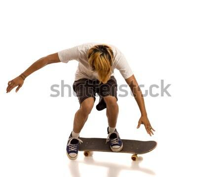 Сток-фото: молодым · человеком · скейтбординга · белый · скейтбордист · человека