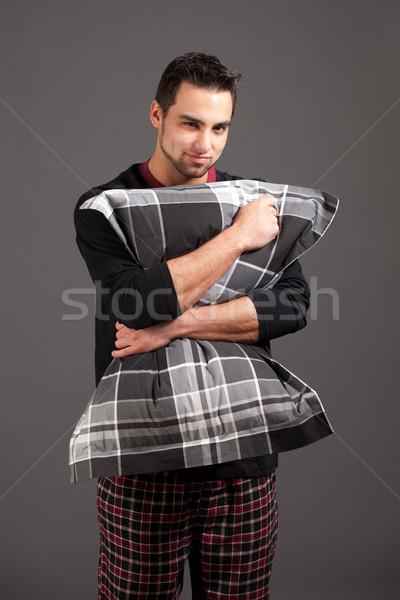 Attractive man in pajamas. Studio shot over grey. Stock photo © nickp37