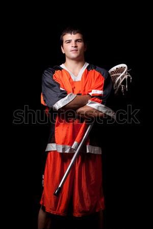 Male lacrosse player. Studio shot over black. Stock photo © nickp37