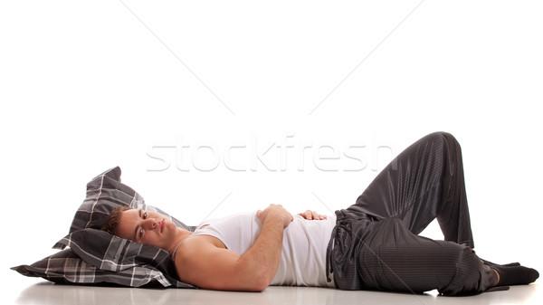Stock photo: Man in pajamas. Studio shot over white.