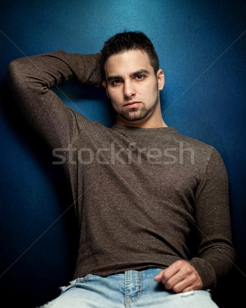 Szeszélyes portré fiatalember kék férfi sötét Stock fotó © nickp37