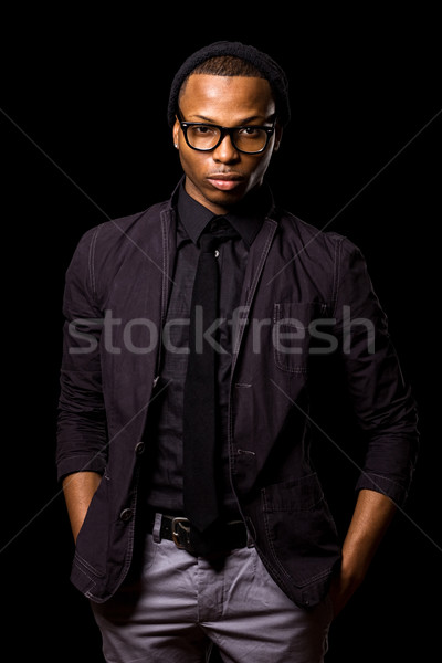 Fashionable young man. Studio shot over black. Stock photo © nickp37