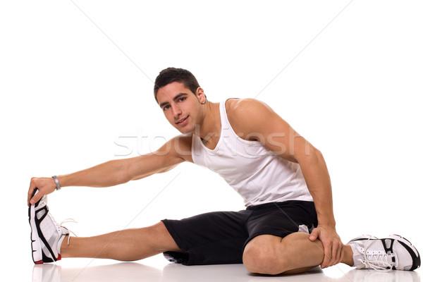 Stock photo: Sitting hamstring stretch. Studio shot over white.