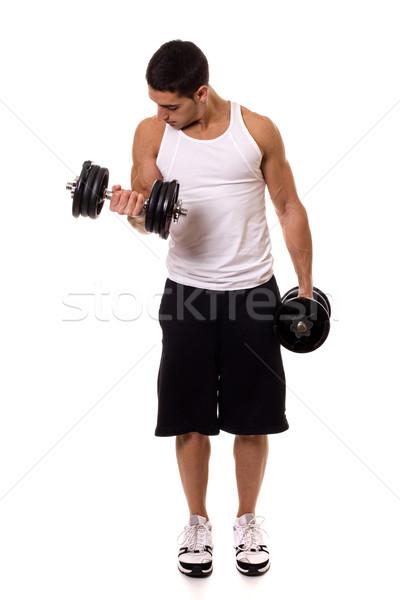 Stock photo: Biceps curl exercise. Studio shot over white.