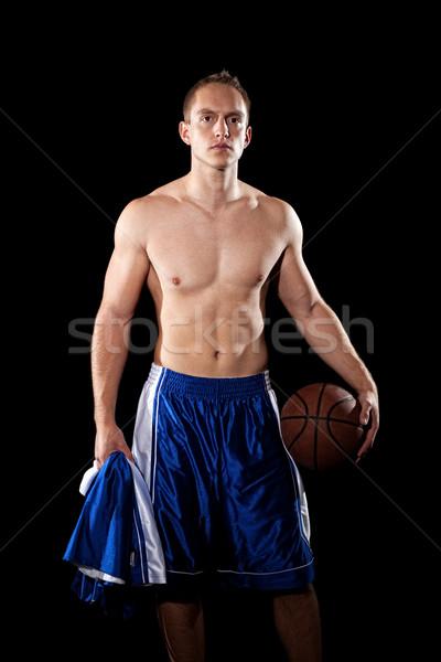 Male basketball player. Studio shot over black. Stock photo © nickp37