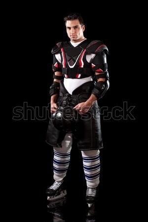 Ice hockey player. Studio shot over black. Stock photo © nickp37