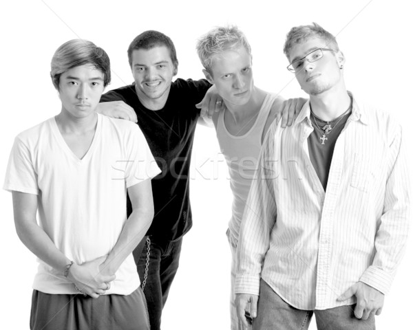 Small group of young men. Studio shot over white. Stock photo © nickp37